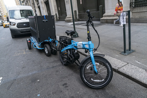 View of Urb-E bike and trailer to be used by Amazon employees for delivery in New York. In order to make delivery more efficient and reduce greenhouse gas emissions by cars Amazon will start delivery in New York using Urb-E bikes and trailers starting October 22, 2020. Urb-E is start-up company and already scored success with their electrical scooters used for delivery inside UPS warehouses in Los Angeles. The move to electric scooters and bikes comes as the U.S. delivery service industry is growing tenfold.