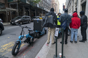 Amazon employees receive lesson on usage of Urb-E bikes for delivery in New York. In order to make delivery more efficient and reduce greenhouse gas emissions by cars Amazon will start delivery in New York using Urb-E bikes and trailers starting October 22, 2020. Urb-E is start-up company and already scored success with their electrical scooters used for delivery inside UPS warehouses in Los Angeles. The move to electric scooters and bikes comes as the U.S. delivery service industry is growing tenfold.
