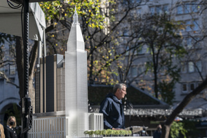 Scale architectural model seen as mayor Bill de Blasio on background speaks during groundbreaking ceremony for One Madison Avenue at Madison Square Park. More than one billion dollars were committed to create this green project.