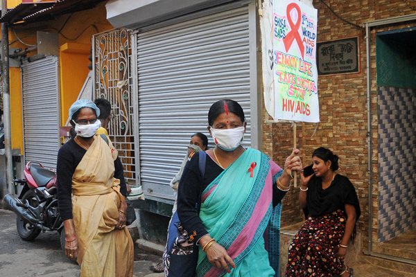 Social activists and sex workers take part in a campaign rally to create awareness about HIV AIDS on the occasion of  World AIDS Day at Sonagachi, Red light area.