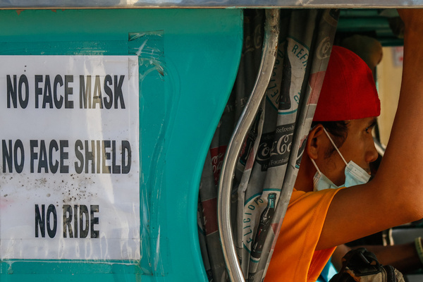 Jeepney passenger improperly wears his face mask without face shield in Quezon City on January 22, 2021. Face mask and face shield are mandatory specially in public places and transportation to avoid the spread of coronavirus. As of January 22, 2021, Philippines has now more than 500,000 cases of COVID-19 and 10,116 deaths.