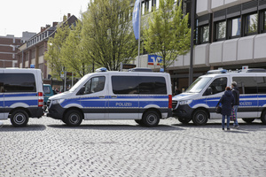 """Several Police vans separate the right-wing protest from the stage where a multi-media show will be performed later in the day. Around 10 protesters from the two right-wing parties """"Die Rechte"""" and NPD (National Democratic Party of Germany) protested in Worms at the 500th anniversary of the appearance of the Reformator Martin Luther at the Diet of Worms. They protested against the instrumentalisation of Martin Luther by the German Protestant Church and wanted to put his national aspects more to the forefront. The protest was confronted by around 100 counter protesters."""
