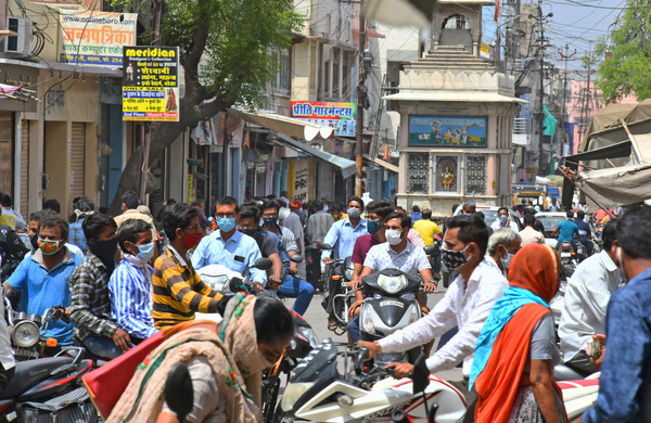 Commuters without maintaining social distancing move through a busy market, amid surge in Coronavirus cases across the country, in Beawar. Rajasthan Government declared lockdown called 'Jan Anushasan Pakhwada' (Public Discipline Fortnight) for prevention of pandemic till 3 May.