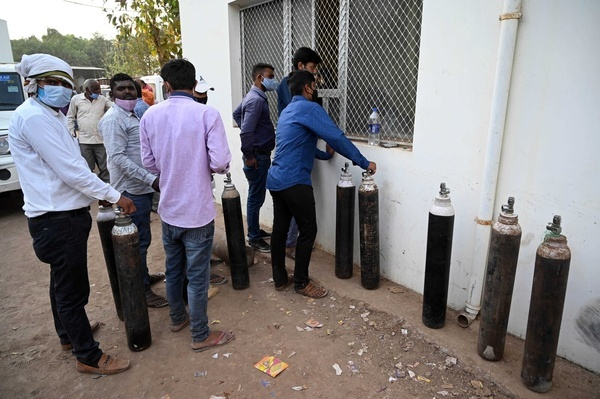 Family members of COVID19 patient in queue to take oxygen cylinder filled with medicated oxygen at a plant as corona virus cases surge across Prayagraj.