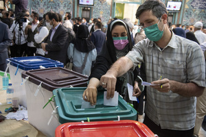 A couple voters cast their ballot for the presidential election at a polling station in Tehran, Iran, Friday, June 18, 2021.