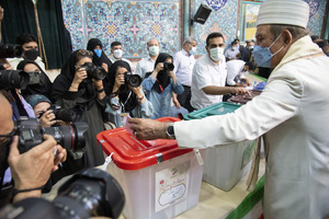 A zoroastrian voter casts his ballot for the presidential election at a polling station in Tehran, Iran, Friday, June 18, 2021.