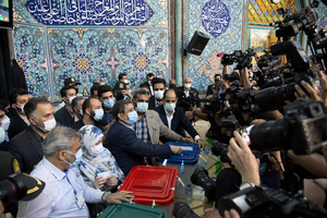 Presidential election candidate Abdolnasser Hemmati, former Central Bank chief, casts his ballot paper while voting at a polling station Tehran, Iran, Friday, June 18, 2021.