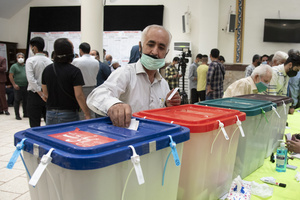 A voter casts his ballot for the presidential election at a polling station in Tehran, Iran, Friday, June 18, 2021.