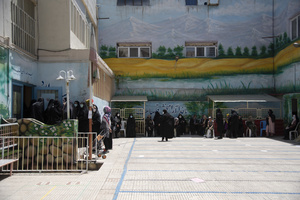 Women queue for voting in the presidential election at a polling station in Tehran, Iran, Friday, June 18, 2021.