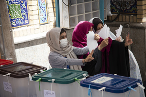 women flash the victory sign after voting at a polling station Tehran, Iran, Friday, June 18, 2021.