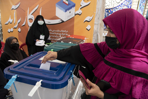 A voter casts her ballot for the presidential election at a polling station in Tehran, Iran, Friday, June 18, 2021.