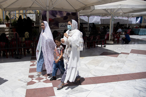 A family walk after voting at a polling station Tehran, Iran, Friday, June 18, 2021.