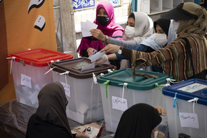 women voters casts their ballot for the presidential election at a polling station in Tehran, Iran, Friday, June 18, 2021.