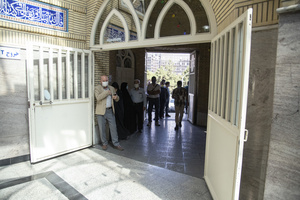 people queue for voting in the presidential election at a polling station in Tehran, Iran, Friday, June 18, 2021.