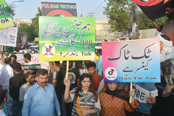"""Pakistani activists of Jamhoori Watan Party (JWP) hold placards and shouting slogans during protest against social media App """"TikTok"""" outside Press Club in Provincial Capital in Lahore. after Pakistan lifted a second ban imposed on TikTok in April over """"immoral and unethical"""" content."""