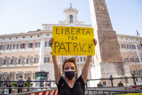 Flashmob in Rome in front of Montecitorio Palace organized by a group of young activists from Amnesty International Italia, in solidarity with Patrick Zaki