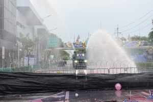 Riot police responded with water cannon to prevent protesters arriving at Government House. Anti-government protesters face the riot police at Nang Loeng intersection as their stand against Prime Minister Prayuth Chan-ocha's administration continues.