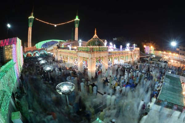 """Pakistani Muslim devotees take part on the annual ''URS'' religious festival at shrine of Sufi Saint Syed Ali bin Osman Al-Hajvery, popularly known as """"Data Ganj Bakhsh"""" in Lahore. Thousands of people traveled from all over Pakistan to attend the celebrations. Data Ganj Bakhsh was a Persian Sufi and scholar during the 11th century. He was born in Ghazni, Afghanistan (990 AD) during the Ghaznavid Empire, settled and died in Lahore spreading Islam in South Asia. During the festival the shrine is lit up with candles, there are donated food for the people and Sufis, who dance and play music for hours."""