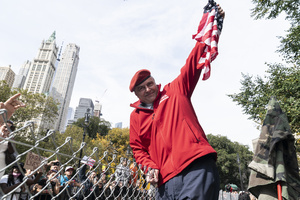 Republican Party mayoral candidate Curtis Sliwa standing on road devider and holding fence greets participants as municipal workers of the city march across Brooklyn bridge and rally at City Hall Park against vaccination mandate. Municipal workers from New York Police Department, Sanitation Department, Fire Department, Department of Education, Department of Correction, Parks Department, City Health and Hospitals, Metropolitan Transit Authority and other city office workers mandated by mayor to get vaccinated against COVID-19 disease by November 1, 2021 or will be left out of work and out of paycheck. More than 5 thousand protesters participated and they were joined by Republican Party mayoral candidate Curtis Sliwa.