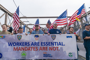 Municipal workers of the city march across Brooklyn bridge and rally at City Hall Park against vaccination mandate. Municipal workers from New York Police Department, Sanitation Department, Fire Department, Department of Education, Department of Correction, Parks Department, City Health and Hospitals, Metropolitan Transit Authority and other city office workers mandated by mayor to get vaccinated against COVID-19 disease by November 1, 2021 or will be left out of work and out of paycheck. More than 5 thousand protesters participated and they were joined by Republican Party mayoral candidate Curtis Sliwa.