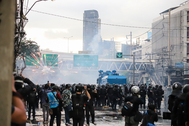 Riot police block road to 1st Infantry Regiment by container and crackdown the Protesters demanding a vaccine against COVID-19 by tear gas, rubber bullets and water canon.