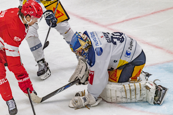 Leonardo Genoni (goalkeeper) of EV Zug makes a stop during the 20th match of the 2021-2022 Swiss National League Season with the Lausanne HC and EV Zug. EV Zug wins 4-3.