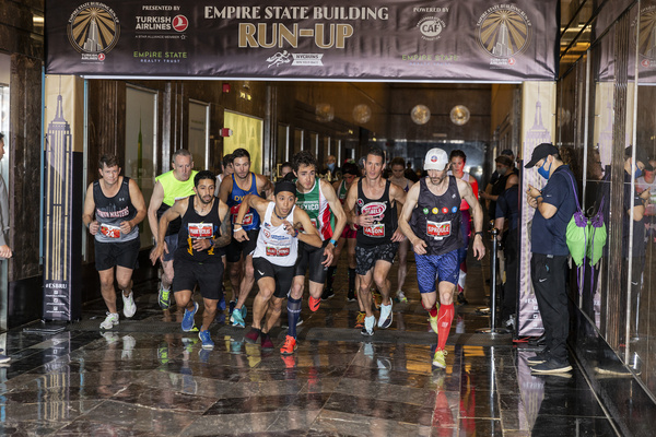 Elite men start running for 43rd Annual Empire State Building Run-Up at Empire State Building Lobby. Athletes were racing up 86 floors, 1,576 steps and 1,050 feet from the lobby to the iconic 86th floor Observatory. Because of the severe storm they were finishing under heavy rain.