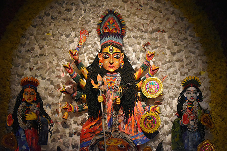 "A paper made Durga Idol inside in a ""pandal"" or temporary platform premises amidst the spread of COVID-19 in Kolkata."