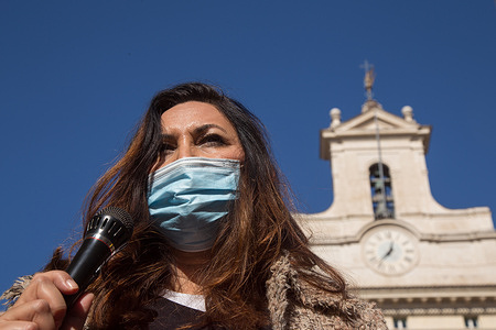 """Flashmob called """"Professionals at Traffic Light"""" in front of Montecitorio Palace in Rome organized by some professionals representing some working categories who cannot work because of the Dpcm, such as theater actors, cooks, journalists, lawyers, show technicians"""