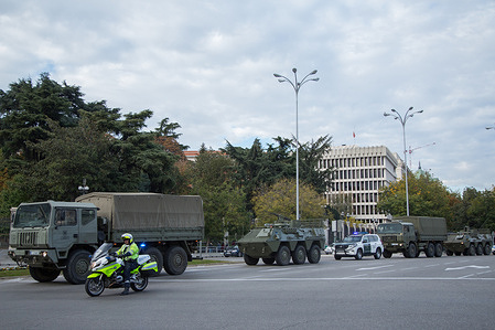 Several military vehicles walk through the center of Madrid for the filming of a series of Alejando Amenabar.
