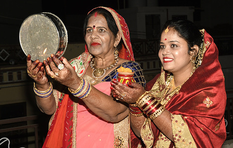 Married Hindu women perform rituals on the occasion of Karwa Chauth festival in Beawar. This traditional Hindu festival celebrated in India sees married women fasting one whole day and offering prayers to the moon for welfare, prosperity and longevity of their husbands. Karva Chauth festival celebrated four days after Purnima (Full Moon Day) in Hindu holy month of Kartika.
