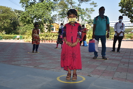 A girl standing at the marked place for entering Science City that managed by National Council of Science Museums (NCSM) under Ministry of Culture, Govt. of India, reopen after 240 days on the 'World Science Day for Peace and Development' for general visitors amid Covid with some restrictions as a measure to prevent spreading the pandemic.
