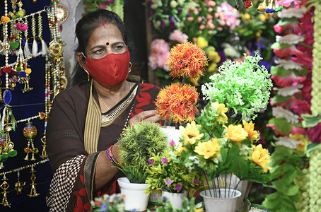 Indian woman buys artificial flowers and decoration items ahead of Diwali festival amid Coronavirus pandemic in Beawar. Diwali or Deepavali marks the triumph of the Good over the evil and the biggest, brightest and most important Hindu festival of India.