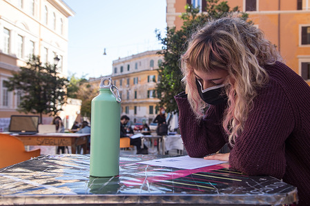 A student while studying in Piazza dell'Immacolata in Rome