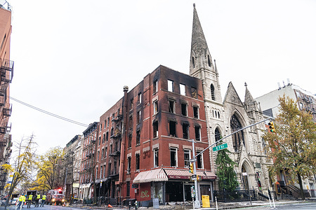 Historic East Village Middle Collegiate Church and adjacent building destroyed by fire on 2nd Avenue in Manhattan. Fire started in a vacant adjacent building and then spread to the 128-year-old Middle Collegiate Church. Six-alarm fire completely destroyed the building and church. According to firefighters, the building will be demolished and the church will undergo structured evaluation. All Tiffany windows and Tiffany skylight dome were destroyed as well.