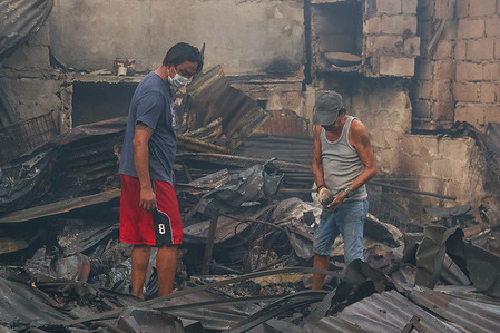 After the 4th alarm fire broke out in residential area in Paco, residents back to their property to secure their houses and search for reusable belongings.