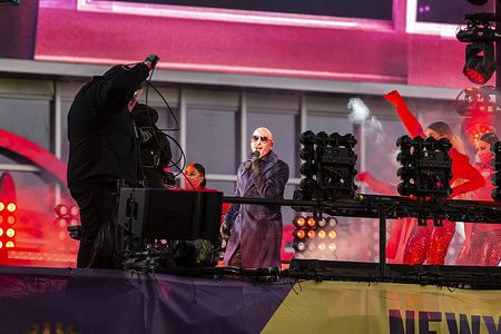 Armando Christian Perez known as Pitbull performs on stage during 2021 New Year celebration on Times Square. Because of COVID-19 pandemic no revelers were allowed to be on Times Square, only few essential workers received special invitations and were seated inside socially distanced pods.