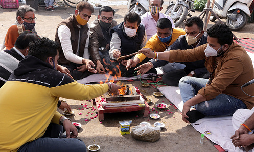 Congress workers perform Intellectual Purification Yagna during protest against PM Narendra Modi led central government over farm reform laws in Beawar. Tens of thousands of farmers have been protesting at key entry points to the national capital of India.
