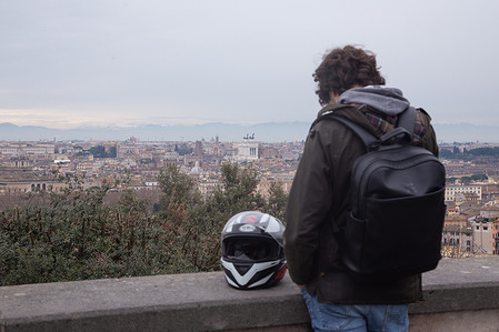 A boy on Piazzale Garibaldi facing the view over Rome