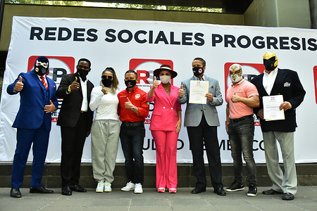 MEXICO CITY, MEXICO JANUARY 13: (L-R) Blue Demon Jr, Mariana Juarez, Hector Hernandez, Malillany Marin, Alfredo Adame, Mistico, Tinieblas, integrants of Progressive Social Networks Political party (RSP)  pose for photos during the pre-registration as a new political party. On January 13, 2021 in Mexico City, Mexico