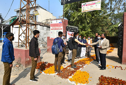 Students greeted by teachers as they arrive to attend classes at a government school that was reopened after remaining closed for 309 days due to COVID-19 pandemic in Beawar.