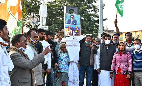 Congress workers raise slogans and burn effigy of Prime Minister Narendra Modi, Home Minister Amit Shah and Senior Journalist Arnab Goswami at a protest against BJP over WhatsApp chats between Republic TV editor-in-chief Arnab Goswami and former BARC CEO Partho Dasgupta, which allegedly indicate leak of classified information, in Beawar.