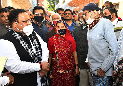 Rajasthan Health Minister Dr. Raghu Sharma interacts with local people during his visit in Beawar.