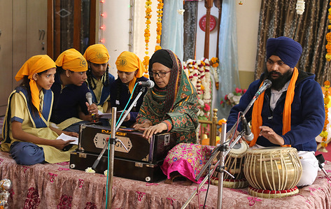 Devotees singing Shabad Kirtan (Sikh devotional song) on the occassion of 355th birth anniversary of 10th Sikh Guru Gobind Singh at a holy Gurudwara in Beawar.