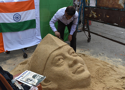 Sculpture artist Swapan Das making a sculpture of the most revered freedom fighter of India Netaji Subhas Chandra Bose with sand on the occasion of Netaji`s 125th birth anniversary.