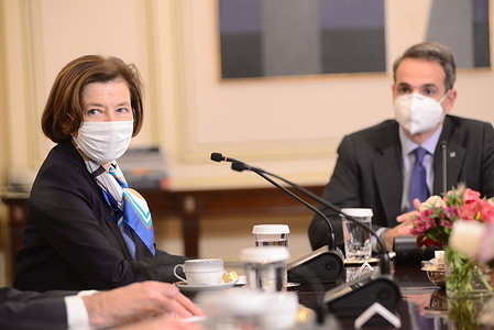 Minister of Defense of France Florence Parly (left) and Greek Prime Minister Kyriakos Mitsotakis (right) during their meeting.