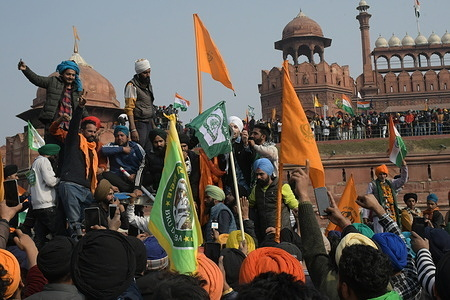 Farmers after install their flag at ramparts of Red Fort in Old Delhi during 26 January Republic Day of India. This is first time when another flag not Indian national flag hoist at Red Fort in history after India get independence.