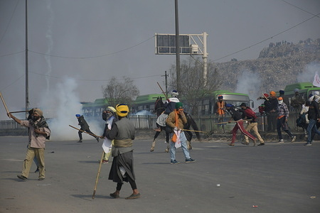 Delhi police personnel firing ter gas on farmers during farmers rally at Singhu Border to Red Fort in Old Delhi on Indian Republic Day.