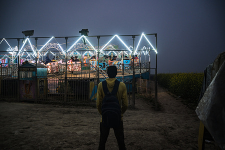 Due to the coronavirus, the number of people in a famous village fair called Chinnomostar Mela Is very low compared to other years. This photo was taken at Tehatta, Nadia, West Bengal.