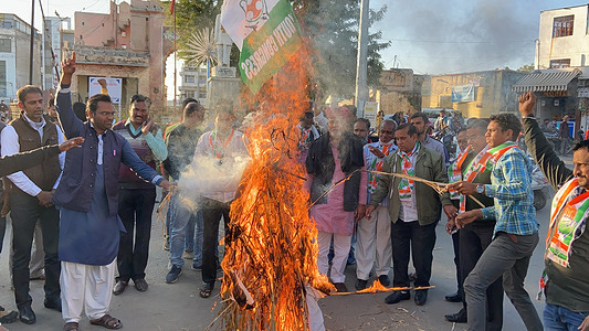 Congress workers raise slogans and burnt effigy of Indian Prime Minister Narendra Modi during a protest against Modi's central government's anti-farmers measures and riots, in Beawar. Farmers have been protesting at Delhi borders with Haryana and Uttar Pradesh since November last year to demand the scrapping of farm laws saying they will hurt their livelihoods.
